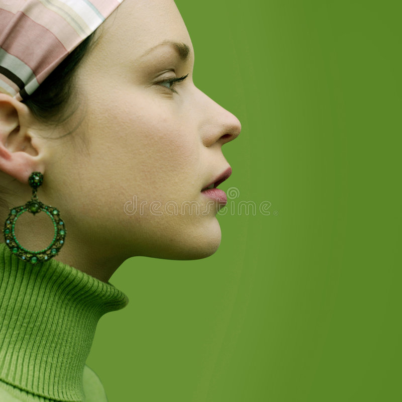 Pretty in Green. Close Up of a beautiful woman in retro hairstyle