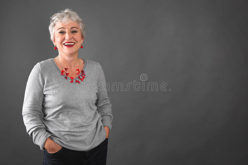 Pretty in Grey - woman in the prime of life. Woman in the prime of life stock photo