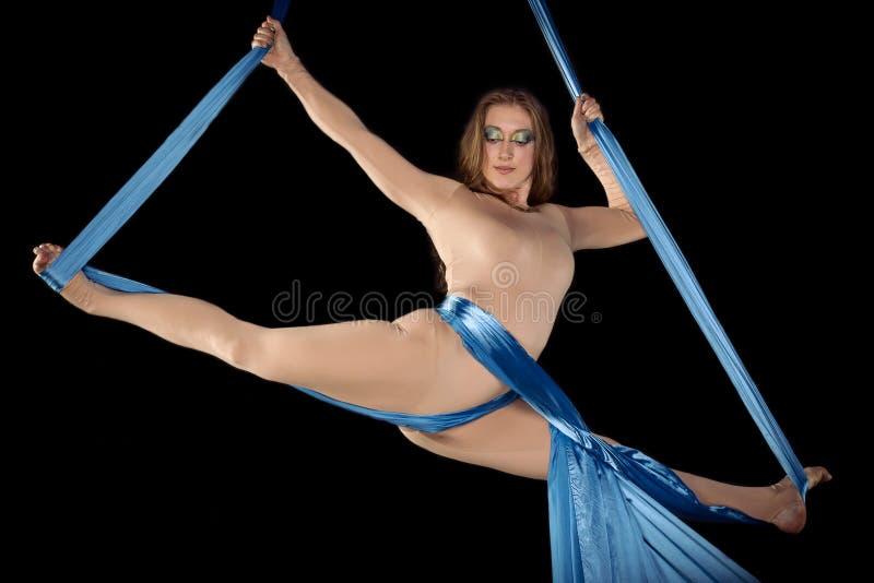 Pretty gymnast training on aerial silk stock images