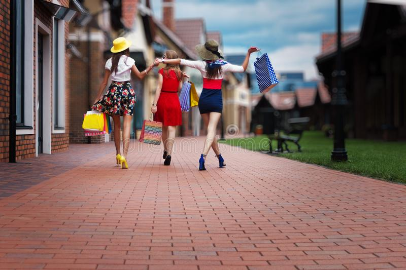 Fashion female women friends in shopping mall royalty free stock photography