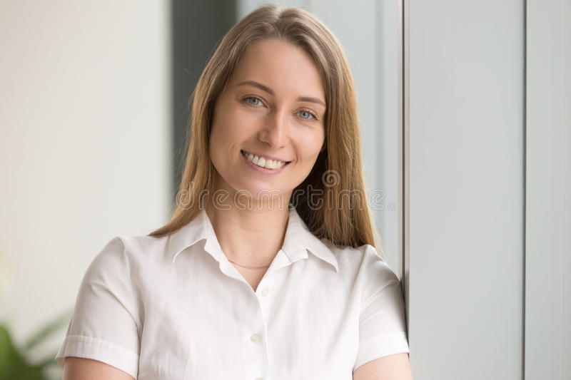 Pretty happy businesswoman looking at camera and smiling, headsh. Pretty happy businesswoman looking at camera, head shot portrait of friendly attractive life royalty free stock photos