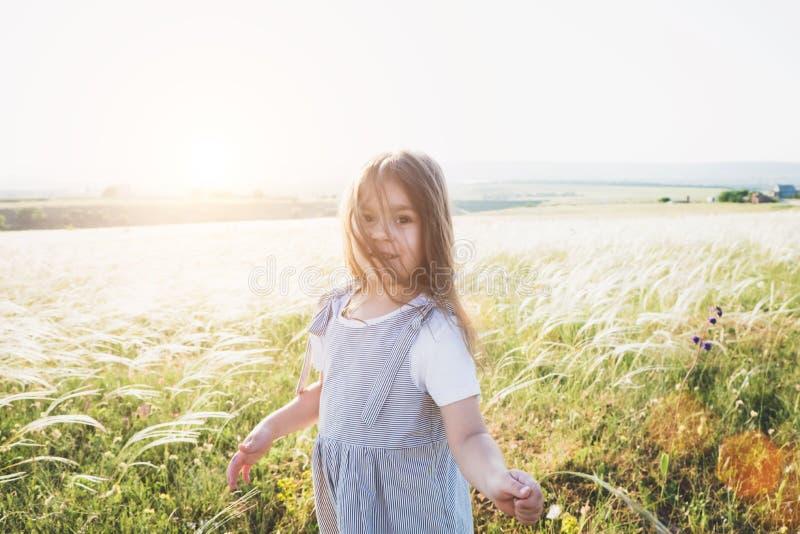 Pretty happy little girl portrait in beautiful landscape stock photo