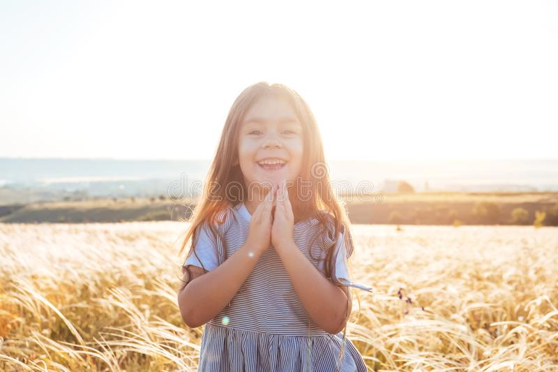 Pretty happy little girl portrait in beautiful landscape royalty free stock image