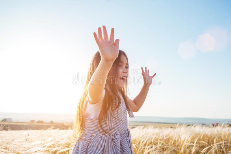Pretty happy little girl portrait in beautiful landscape royalty free stock images