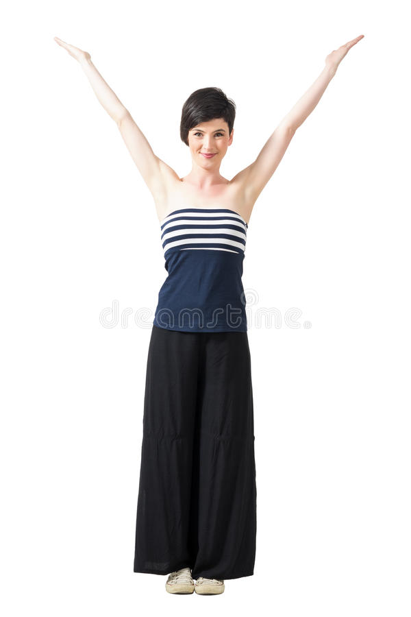 Pretty happy short hair woman shaping letter V with her arms royalty free stock photography