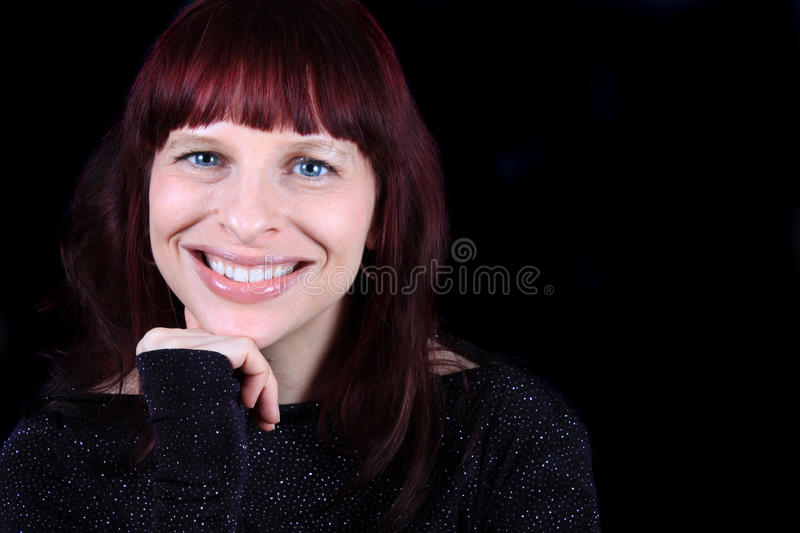 Pretty, happy smiling redhead stock images