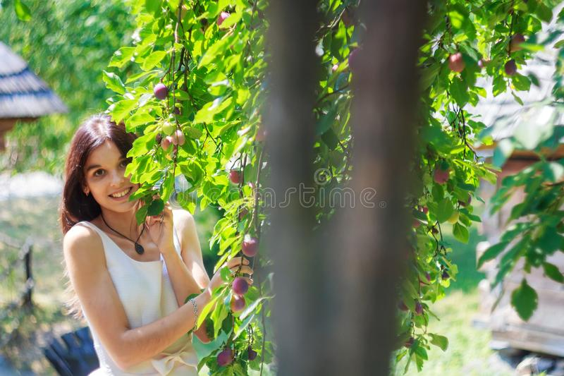 Pretty happy teenager girl walking outdoors. In the summer park, female, young, nature, beautiful, people, woman, lifestyle, person, green, cute, outside, fun royalty free stock photography