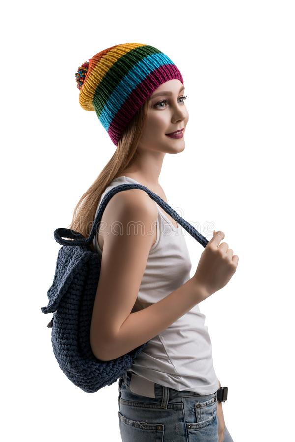 Pretty teenager with blue knitted bag profile shot royalty free stock photos