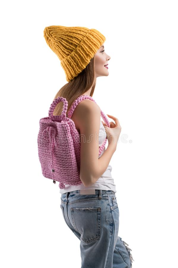 Pretty teenager with knitted bag profile shot royalty free stock photos