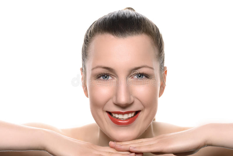 Pretty healthy woman wearing red lipstick. Resting her chin on her hands looking at the camera with a vivacious friendly smile full of vitality in a wellness royalty free stock photography