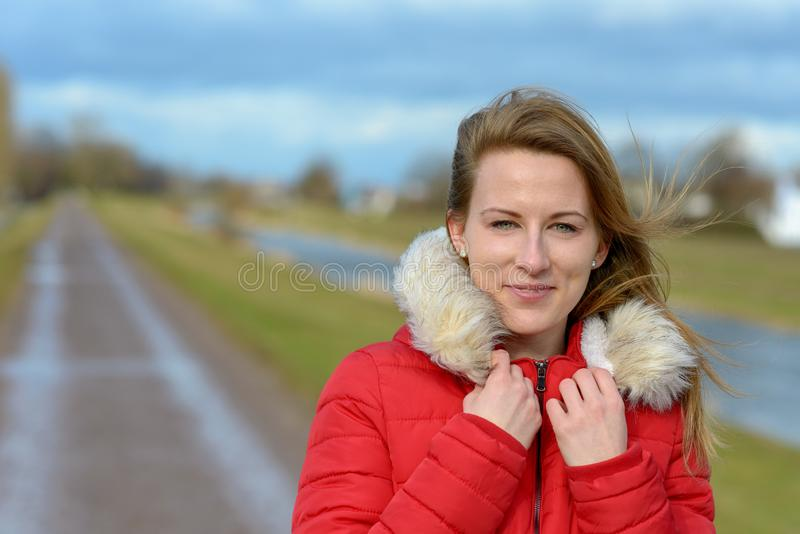 Pretty healthy young woman with long blond hair royalty free stock photos