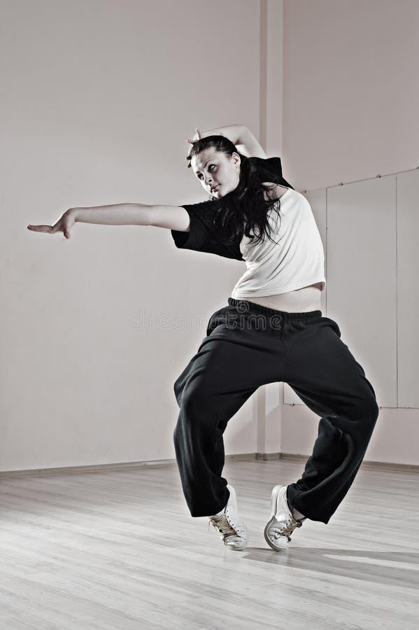 Pretty hip-hop girl in dance stock photos