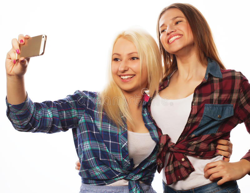 Pretty hipster girls taking selfie. stock photo