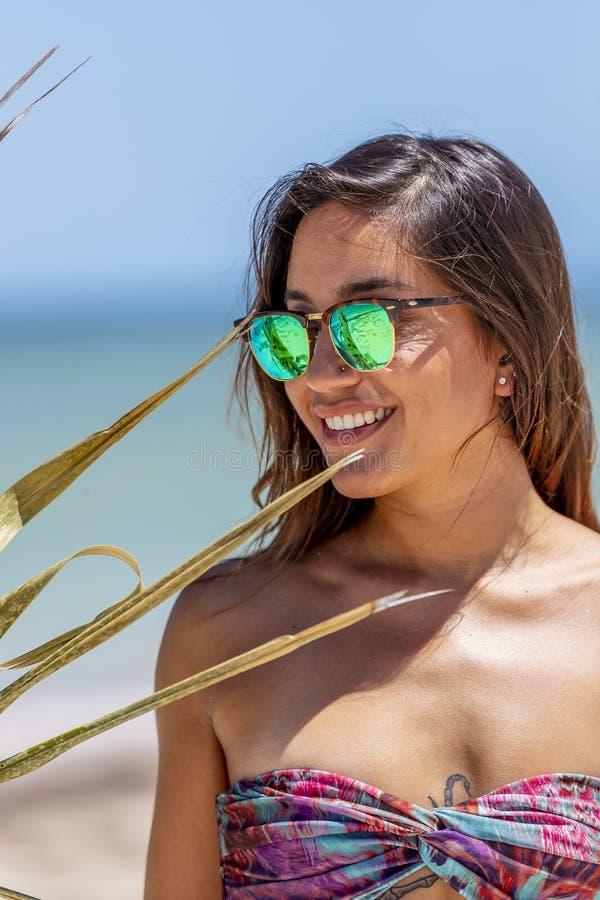 Pretty Hispanic Brunette Model Enjoying A Sunny Day At The Beach royalty free stock image