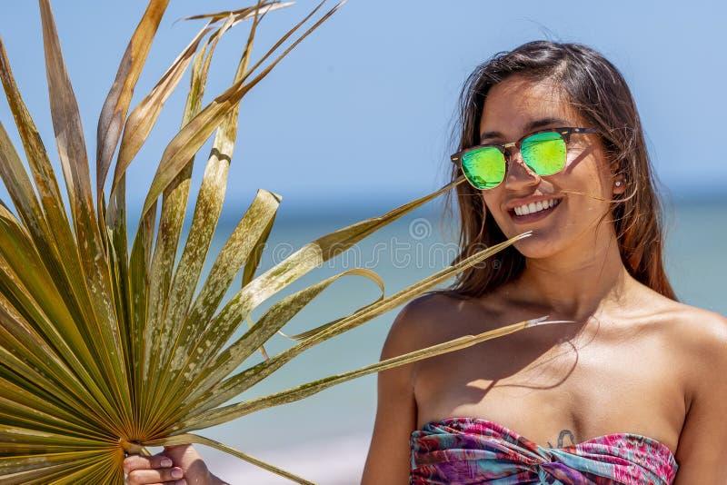 Pretty Hispanic Brunette Model Enjoying A Sunny Day At The Beach stock images