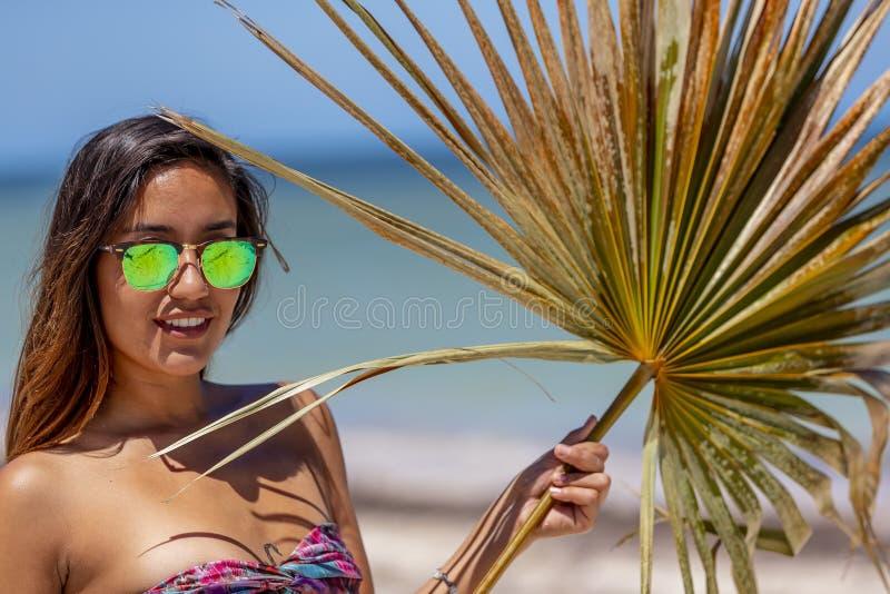 Pretty Hispanic Brunette Model Enjoying A Sunny Day At The Beach stock photography