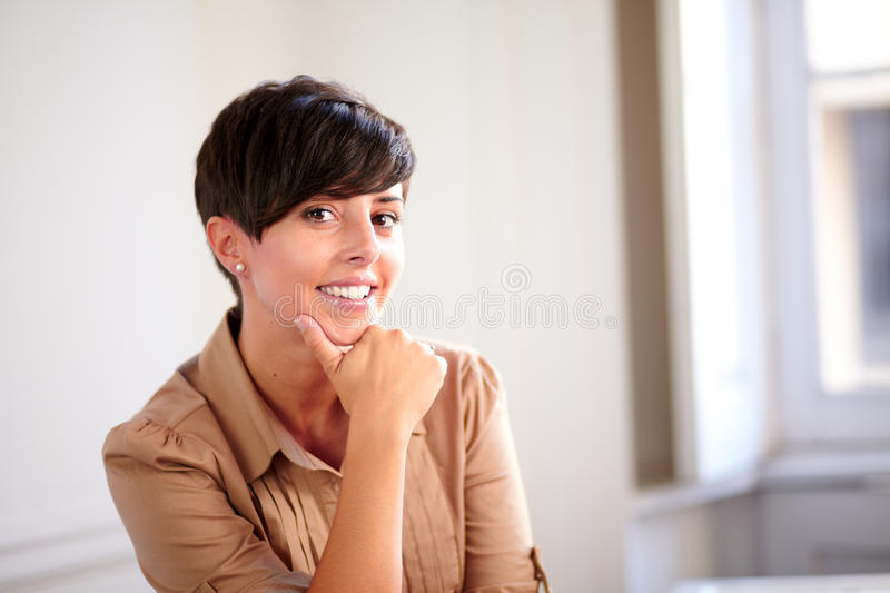 Pretty hispanic businesswoman smiling at you stock photography