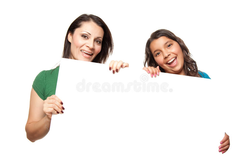 Pretty Hispanic Girl and Mother Holding Blank Boar stock images