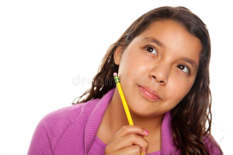 Pretty Hispanic Girl Thinking with Pencil royalty free stock photo