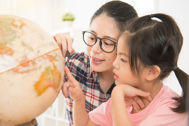 Pretty homeschooling mother teaching daughter royalty free stock photo