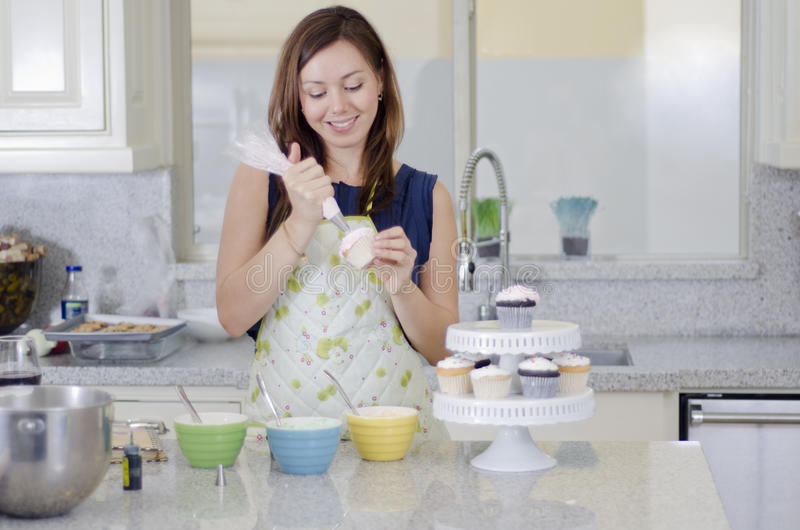 Download Pretty Housewife Making Cupcakes Stock Photo - Image: 34489528