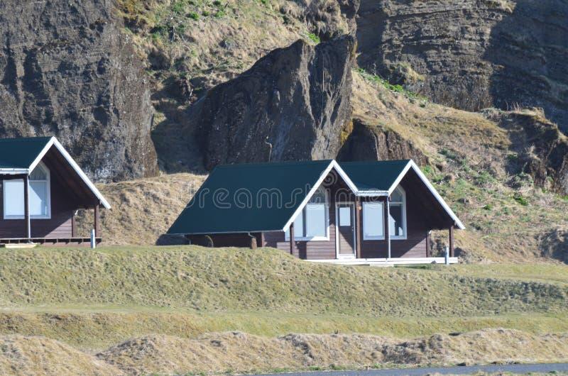 Small pretty cabins in the scenic icelandic coast stock photo