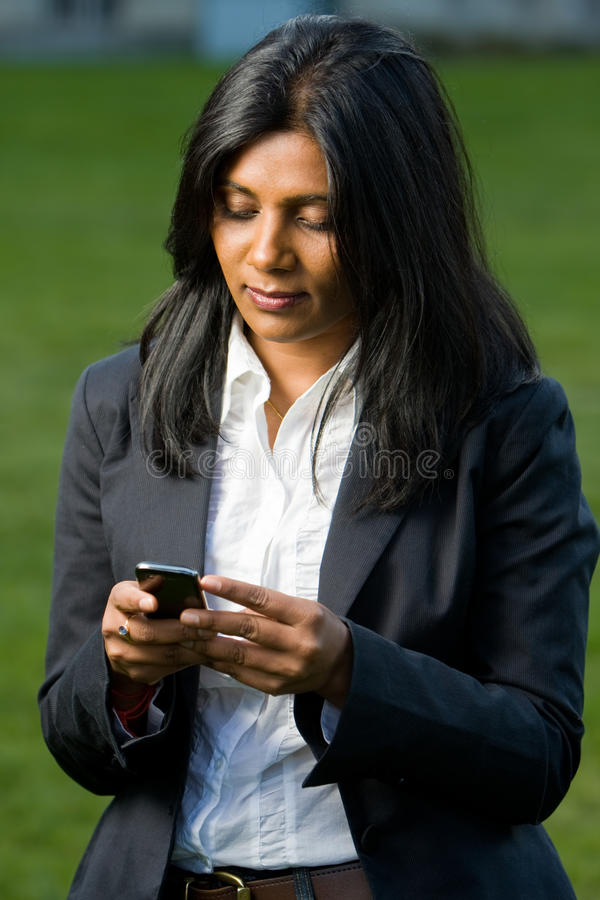Pretty Indian Girl Using Mobile Phone Stock Image