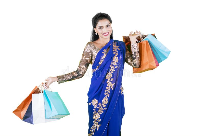 Pretty Indian woman carrying shopping bags stock photo