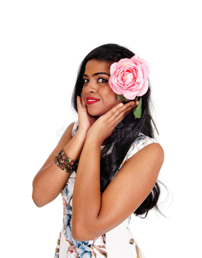 Pretty Indian woman with pink rose. royalty free stock images