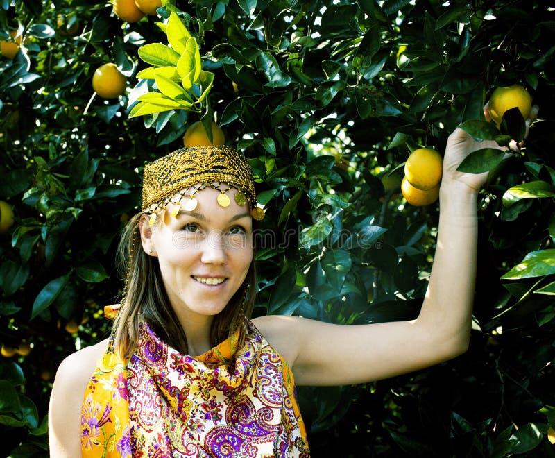 Pretty islam woman in orange grove smiling, real muslim girl. Cheerful stock photos