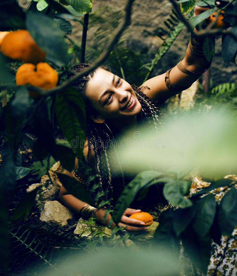 Pretty Islam woman in orange grove smiling. Among trees royalty free stock photos