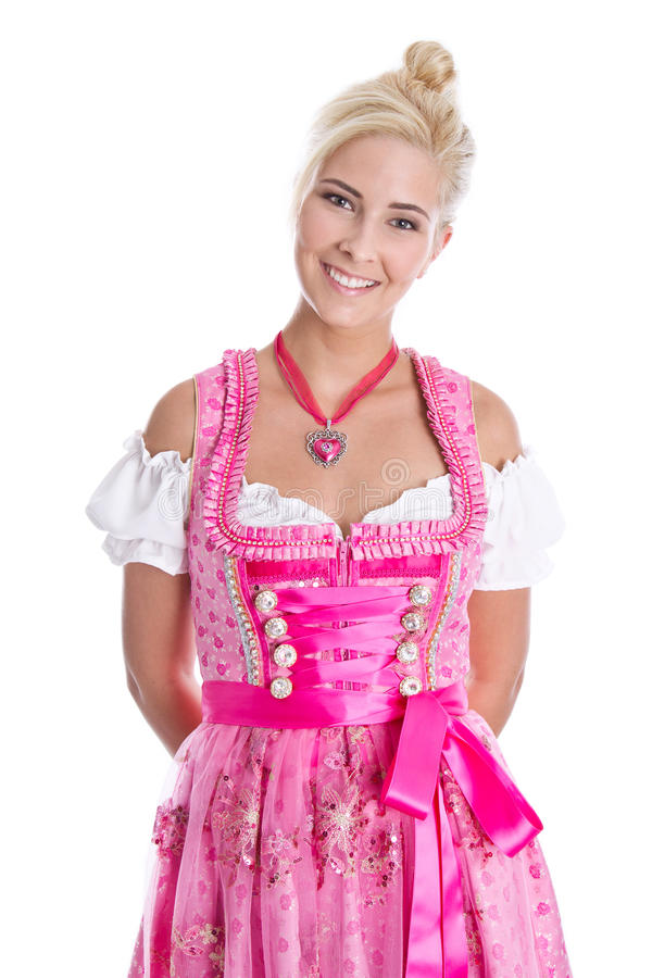 Pretty isolated young woman wearing bavarian dress called dirndl. Beautiful young woman isolated on white wearing pink or rose bavarian dress royalty free stock photography