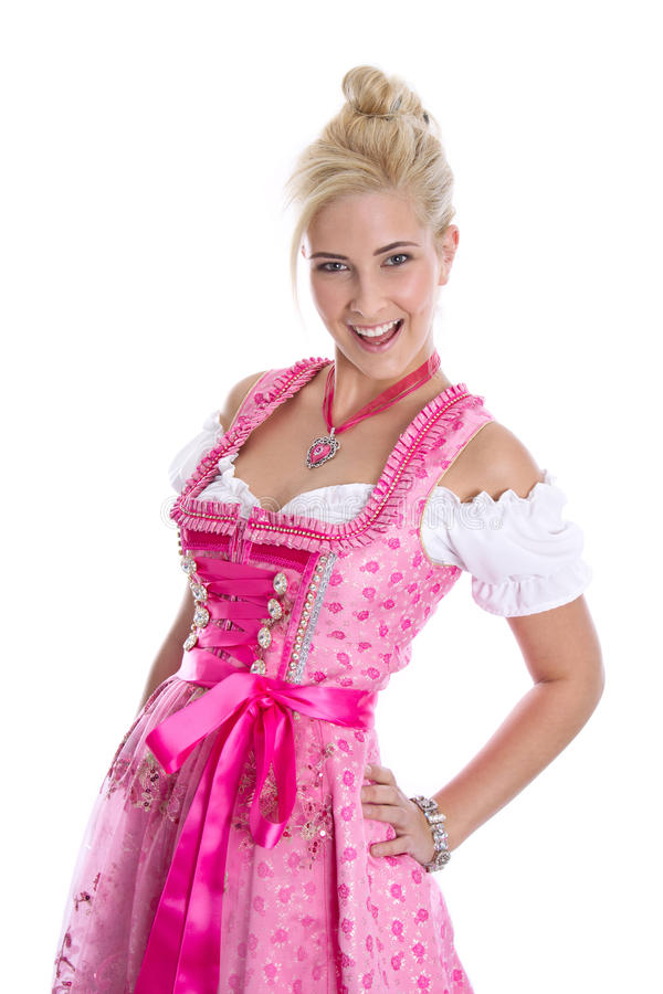 Pretty isolated young woman wearing bavarian dress called dirndl. Beautiful young woman isolated on white wearing pink or rose bavarian dress royalty free stock images