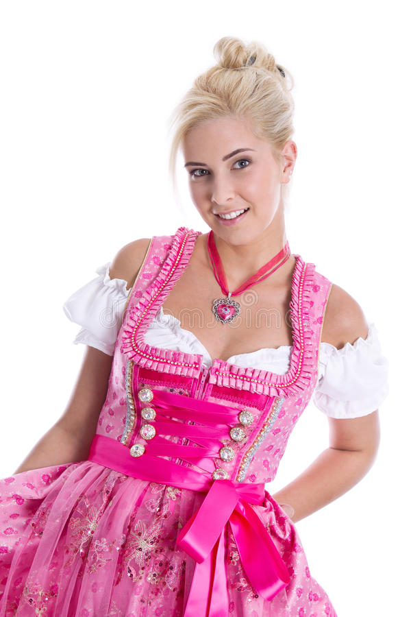 Pretty isolated young woman wearing bavarian dress called dirndl. Beautiful young woman isolated on white wearing pink or rose bavarian dress stock image