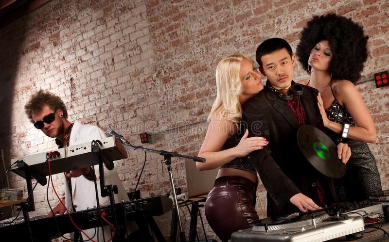 Pretty Ladies Surrounding a DJ royalty free stock photography