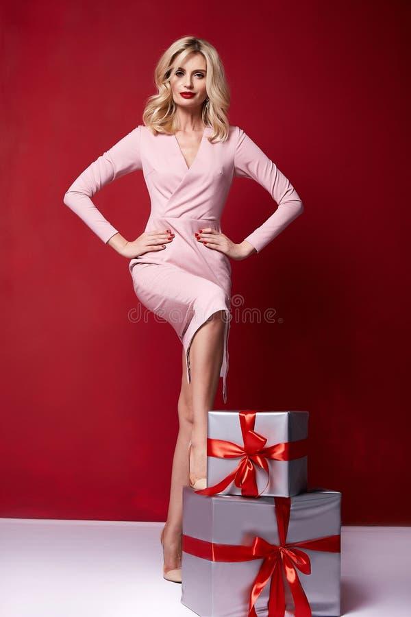 pretty lady fashion model beautiful woman wear style skinny knitted dress celebration happy holidays merry Christmas Eve New royalty free stock image