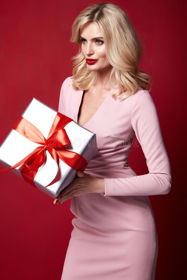 Pretty lady fashion model beautiful woman wear style skinny knitted dress celebration happy holidays merry Christmas Eve New. Year party St. Valentine`s Day royalty free stock photos