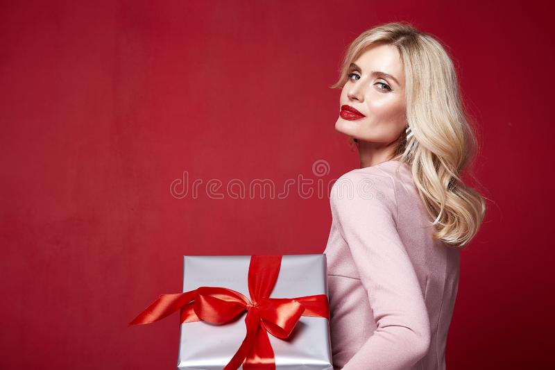Pretty lady fashion model beautiful woman wear style skinny. Knitted dress celebration happy holidays merry Christmas Eve New Year party St. Valentine`s Day royalty free stock images