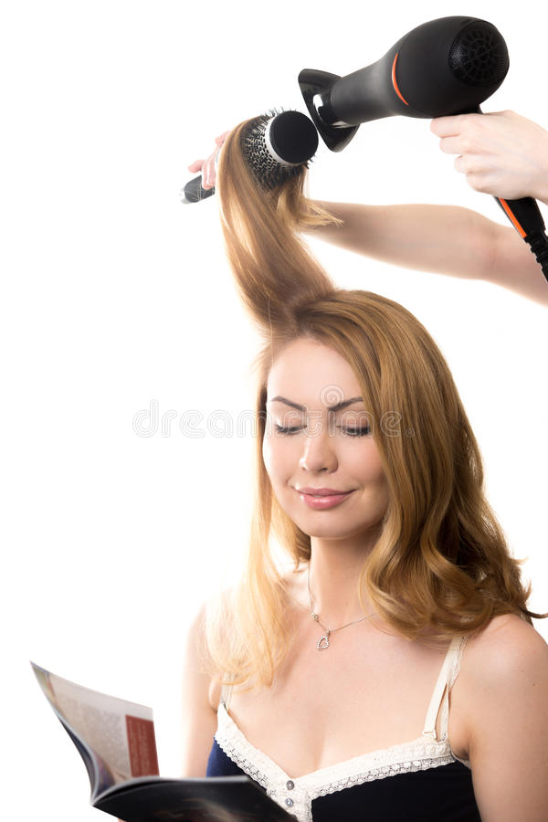 Pretty lady in hair salon stock images