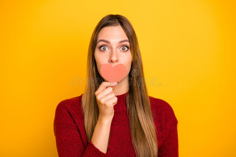 Pretty lady hide mouth with help of little heart figure card dislike going date wear pullover isolated yellow background. Pretty lady hide mouth, with help of royalty free stock images