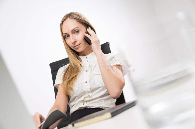 Pretty lady on phone royalty free stock photography