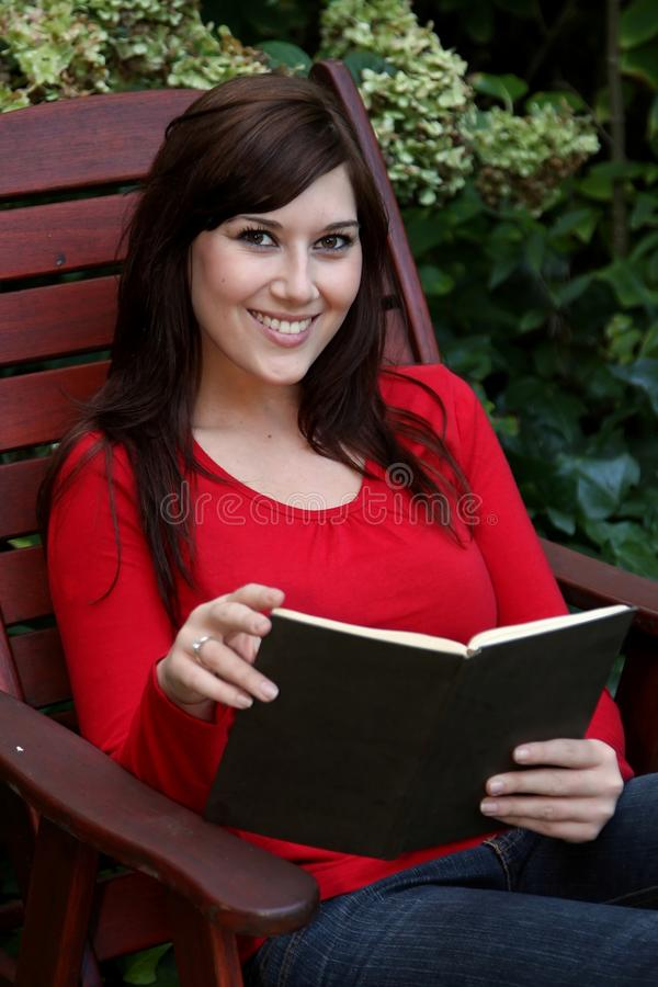 Pretty Lady Reading Book stock photography