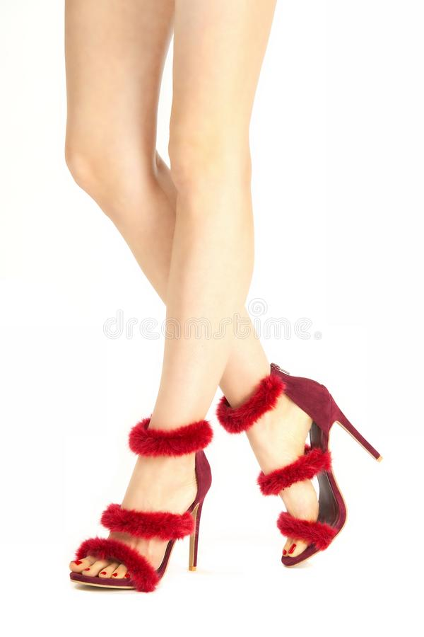 Pretty legs in fancy stiletto high heels sandals. Pretty legs in and fancy stiletto high heels isolated on white background royalty free stock photo
