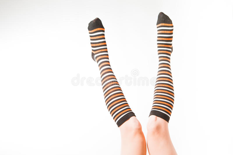 Pretty legs in a long multi-colored socks stock photos