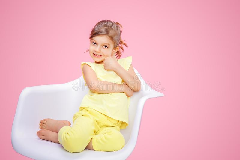 Stylish girl showing thumb up on pink stock images