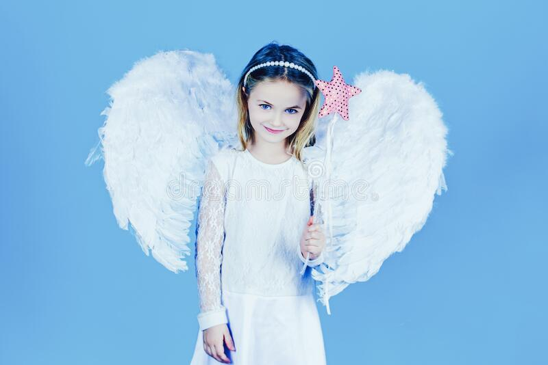 Pretty little angel girl. Valentines day. Christmas Cute little Angel. Cute toddler girl in white wings as Cupid. stock images