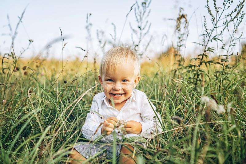Pretty little baby boy have fun outdoor stock photo