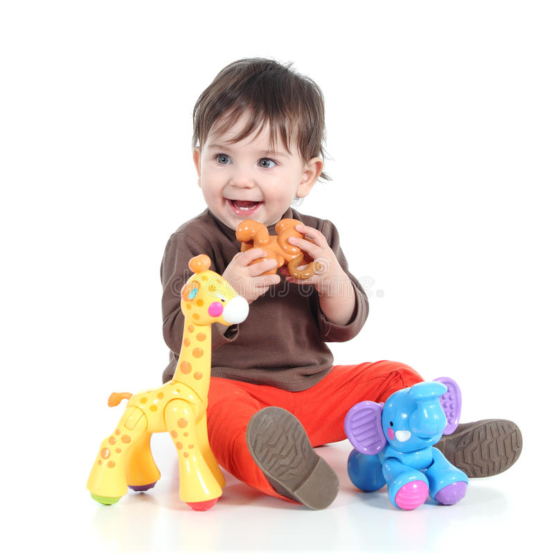 Pretty little baby girl playing with animal toys royalty free stock photos