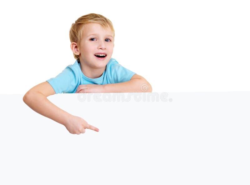 Pretty little boy points on the postcard stock photo