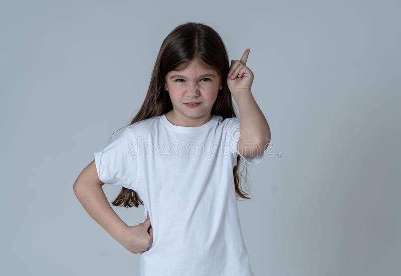 Pretty little girl with a angry facial expression pointing and looking mad at the camera stock photos